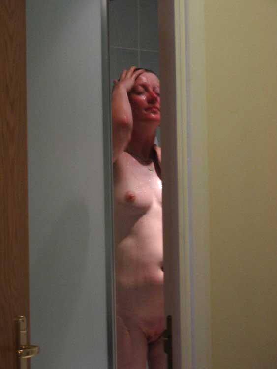Nude showering babe Frances in spy cam peeking voyeur photography